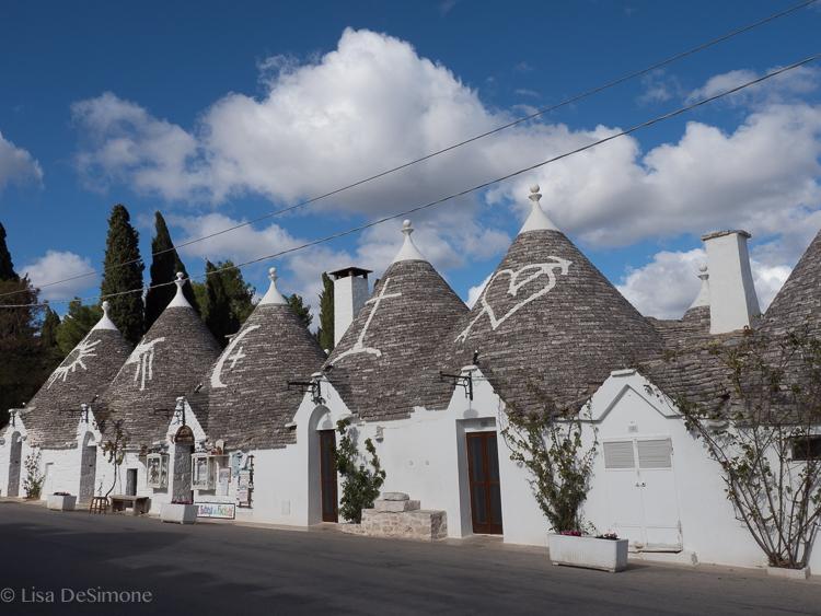 Souvenir shops line the commercial district of Alberobello