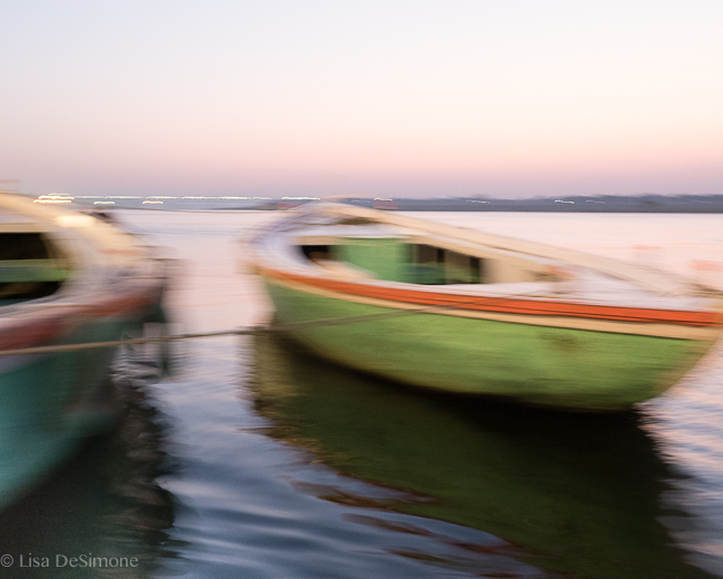 Boats at sunrise on the Ganges River in Varanasi, India.