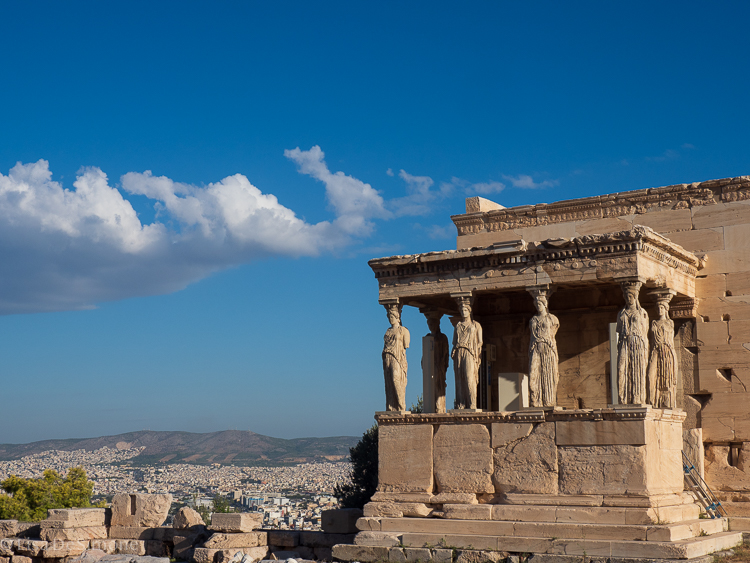 The famous ancient statues overlooking modern Athens