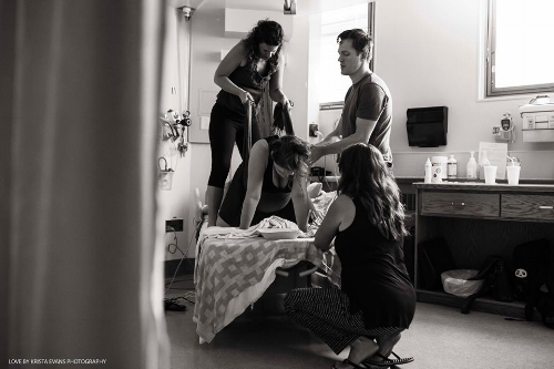 Incredible image of a rockin' birth team by the talented Krista Evans Photography