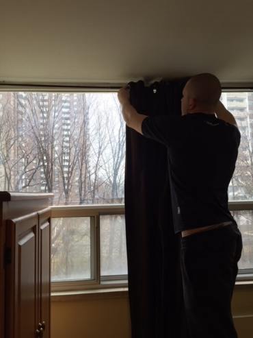 Mike put up the drapes in the bedroom