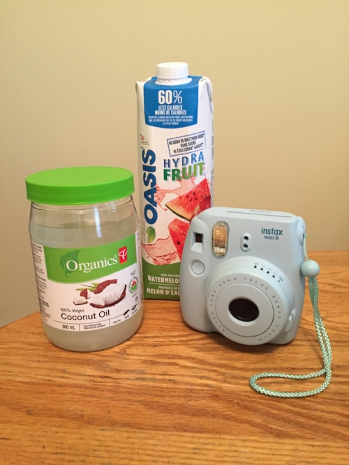 A few fun things to bring with to the hospital. Coconut oil for massage and on baby's bum. No-sugar-added fruit juice for energy in labor. A polaroid camera.