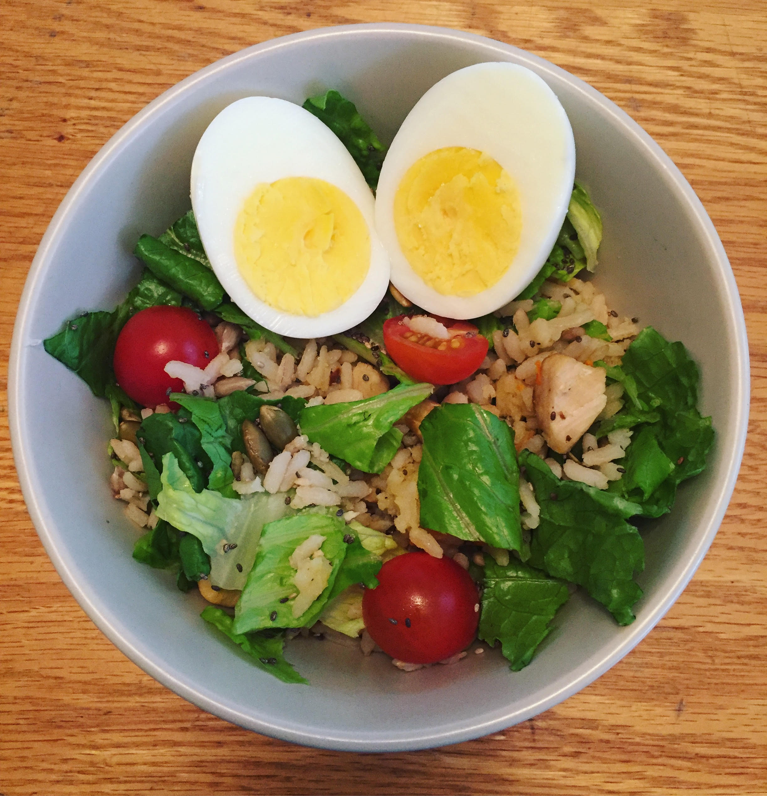 Delicious lunch, hard boiled eggs, salad, rice & chicken
