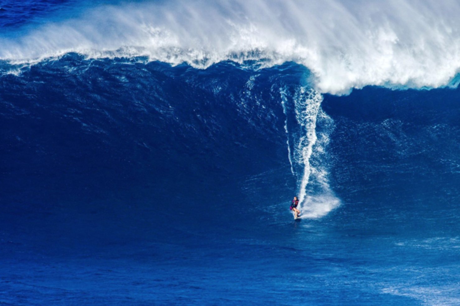 Bethany Hamilton, surfing a 40 ft wave at Jaws in Hawaii. 6 months after giving birth. She is incredible.