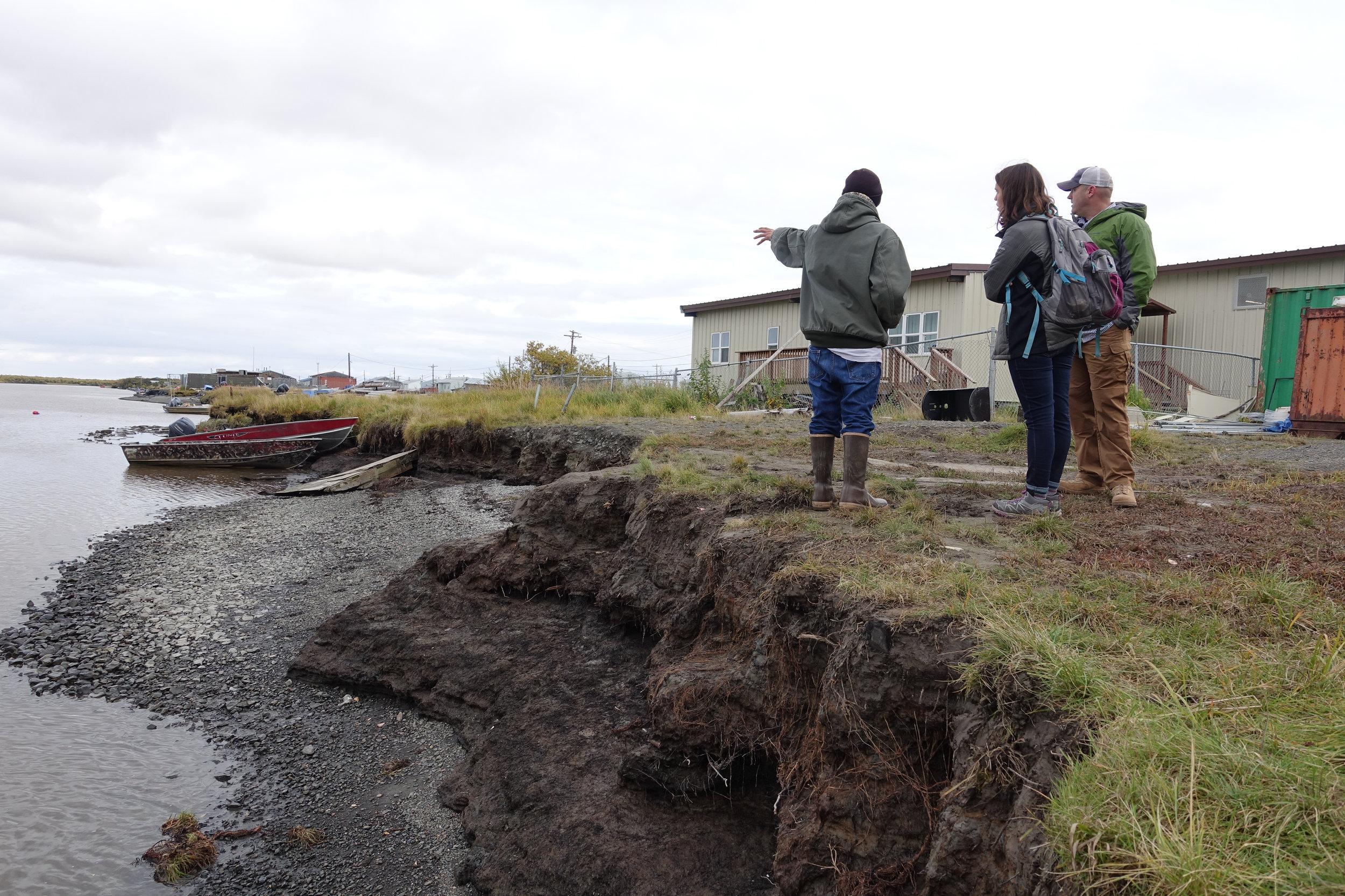 Kotlik Natives in Alaska survey usteq damage on the riverfront (Photo: ANTHC)