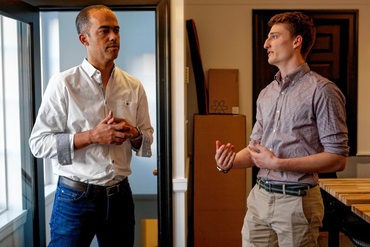 Tim Mitrovich of Kayon Accelerator, left, talks with UMass Amherst student Eli Bucher Dec. 14, 2016 at AmherstWorks coworking space on Amity Street. Kayon Accelerator is a new Amherst-based entity that will help entrepreneurs with seed capital and hands-on assistance starting in February. In exchange, Kayon will take ownership in small pieces of the companies it invests in.    GAZETTE STAFF/SARAH CROSBY