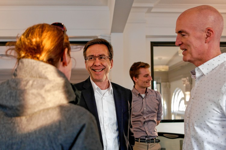 Rebecca Spencer of Amherst, left, David Vogel of Kayon Accelerator, UMass Amherst student Eli Bucher and Steve Garrow of Kayon Accelerator talk Dec. 14, 2016 at AmherstWorks coworking space on Amity Street. Kayon Accelerator is a new Amherst-based entity that will help entrepreneurs with seed capital and hands-on assistance starting in February. In exchange, Kayon will take ownership in small pieces of the companies it invests in.    —GAZETTE STAFF/SARAH CROSBY
