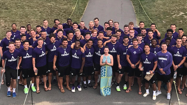Miller (center) lead a mindfulness training for the Amherst College football team. (Photo credit: Amherst Mindfulness)