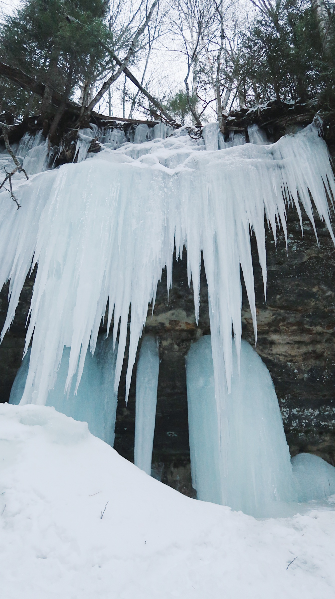 Ice Climbing At Pictured Rocks National Lakeshore A Winter Adventure You Ll Never Forget Em S On The Road