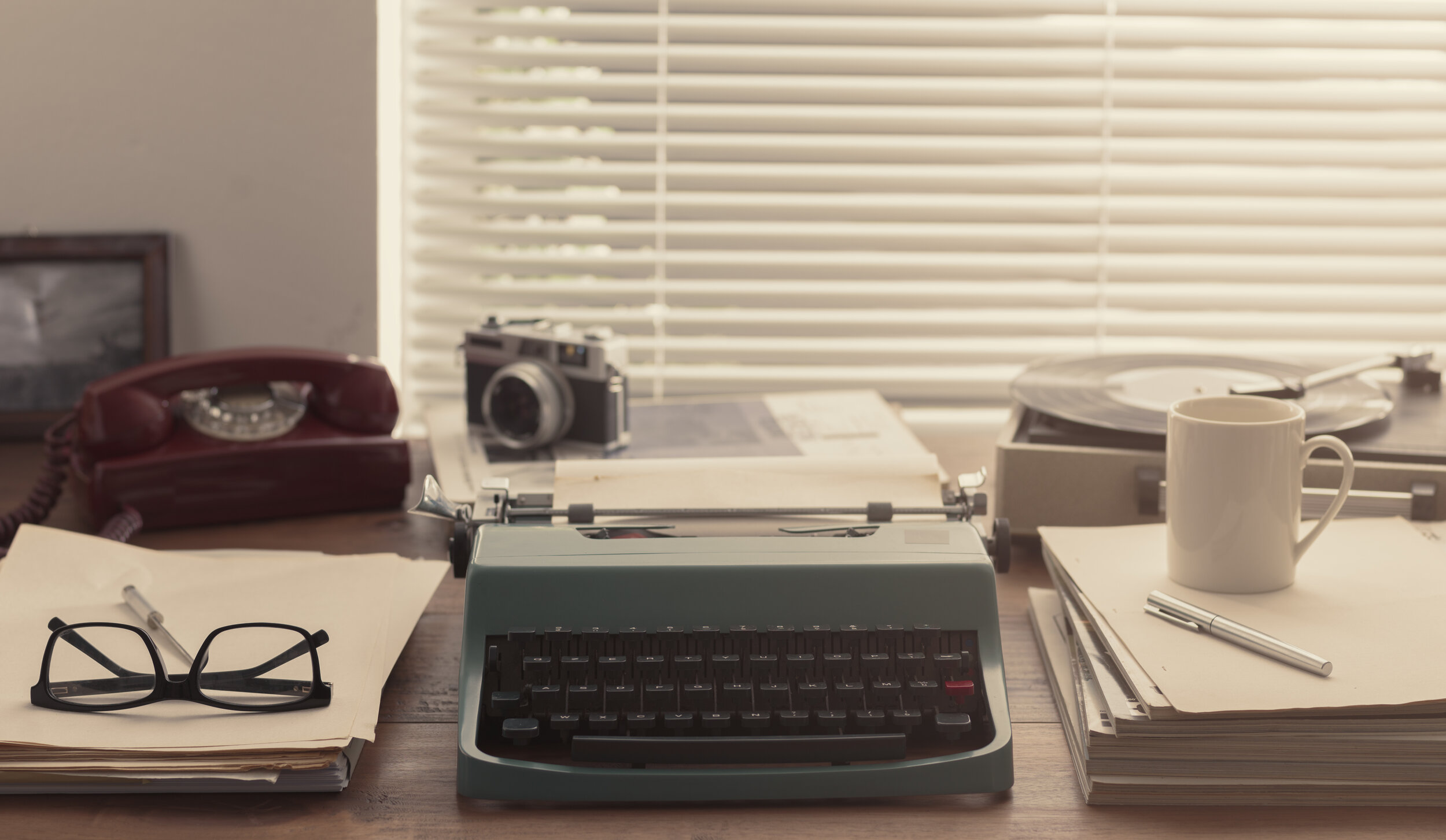 Canva - Writer and journalist vintage desktop with typewriter.jpg
