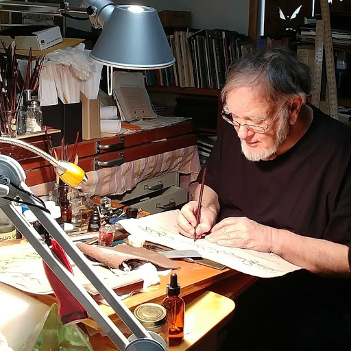 Zakariya hoca in his studio correcting a student's work
