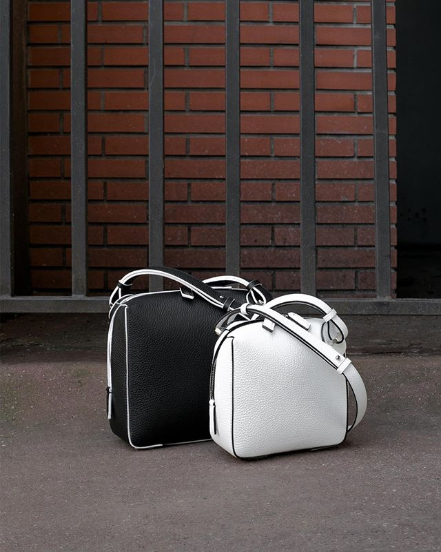 Positive / Negative . The ONE Crossbodys Medium in Black Grain Leather with White Edges & Small in White Grain Leather with Black Edges . Photo @aude_lerin  Styling @nicolasbaurain . #baurain #baurainofficial #barbicanism #unisex #genderless #model #accessories #bags #contrast #blackandwhite #positivenegative #iwant #ineed #bagporn