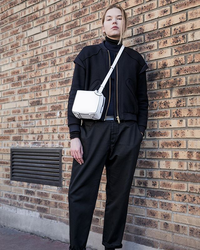 Looking good . THE ONE Crossbody in White Grain Leather with Black Edges . Photo @aude_lerin  Casting @zita_meszaros_paris  Make-up/Hair @mahelia.hgl  Styling @nicolasbaurain . #baurain #baurainofficial #barbicanism #unisex #genderless #bags #accessories #theone #crossbody #leather #iwant #ineed #bagporn #white #whiteandblack #blackandwhite