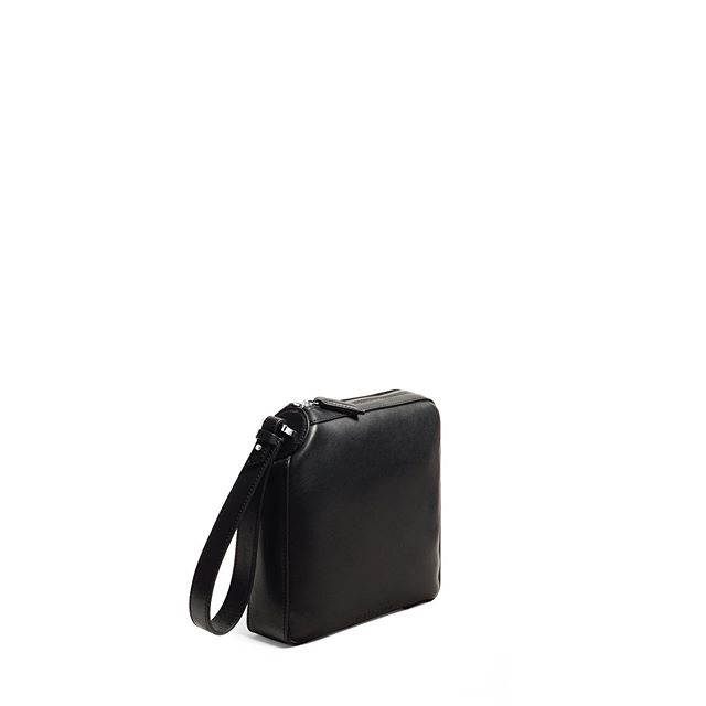 Three Quarter portrait . The ONE Square Clutch in Black Smooth Leather . #baurain #baurainofficial #barbicanism #unisex #genderless #bags #accessories #one #clutch #black #bag #leather #iwant #ineed #bagporn #threequarterview