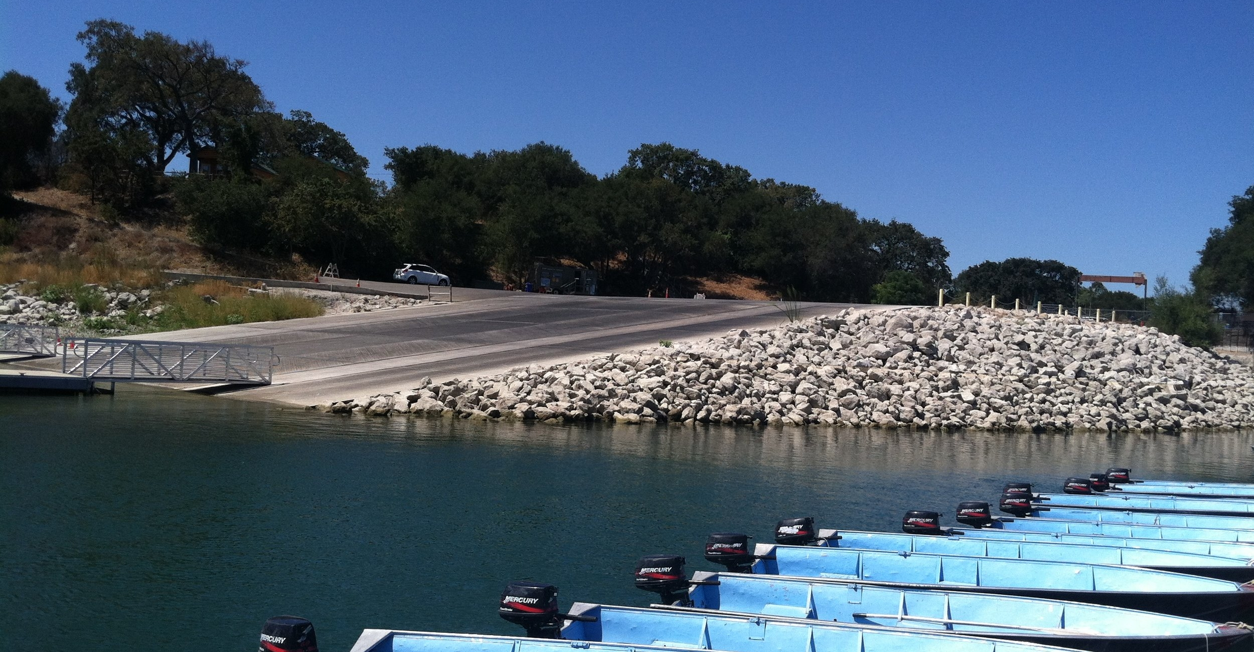 LAKE CACHUMA BOAT RAMP   The Lake Cachuma Boat Ramp project involved complete reconstruction of the boat ramp, parking lot improvements, access improvements from campground, fish-cleaning station and parking lot improvements.  Layout of Approach Road and Stairways  |  Layout of Parking Lot Spaces and Islands  |  Layout of Storm-water Drainage System  |  Location of Dock Anchors  |  Location of Rip-Rap  |  As-Built Survey  |  Quantity Calculations