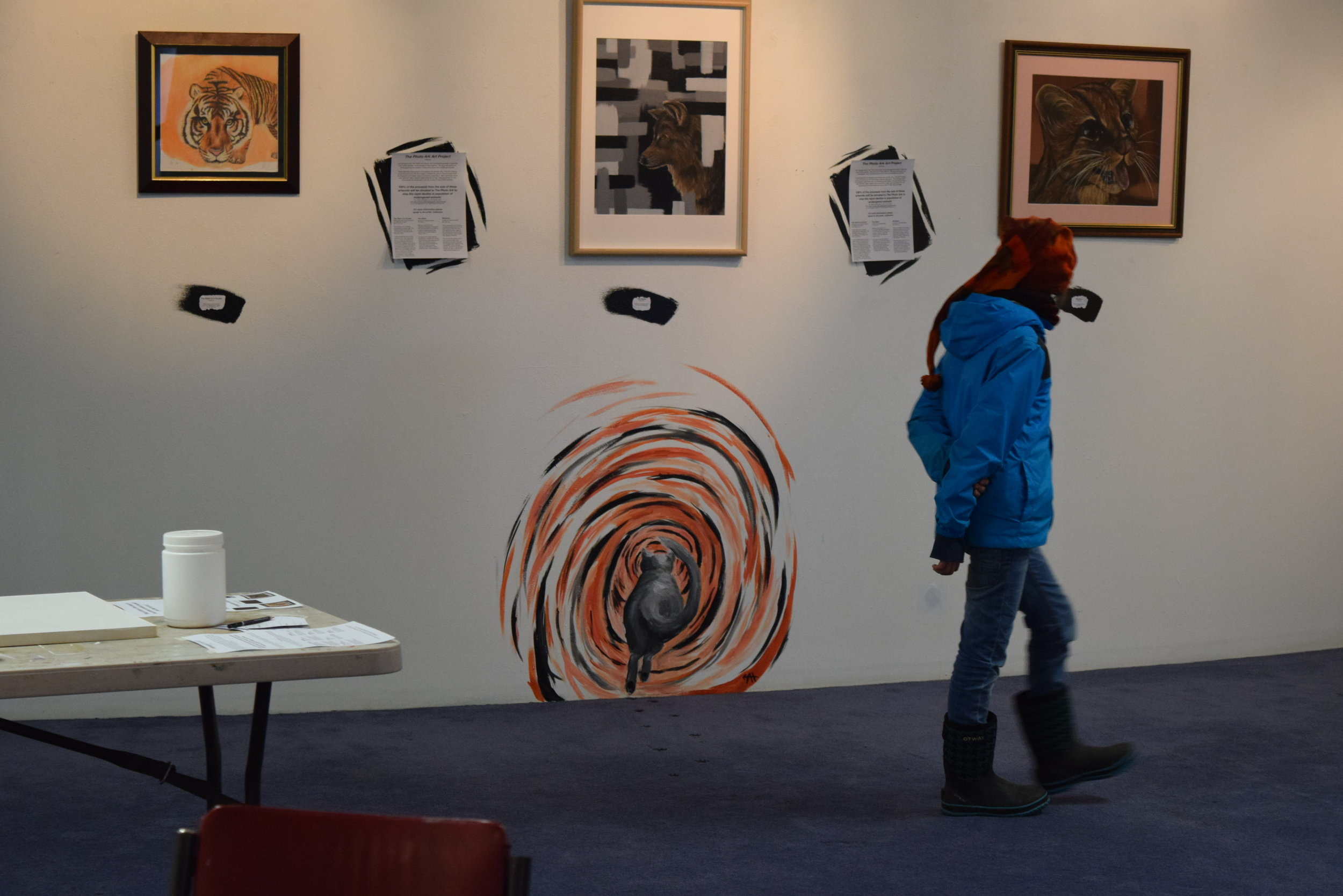 Visitor viewing Catherine Jewell's art