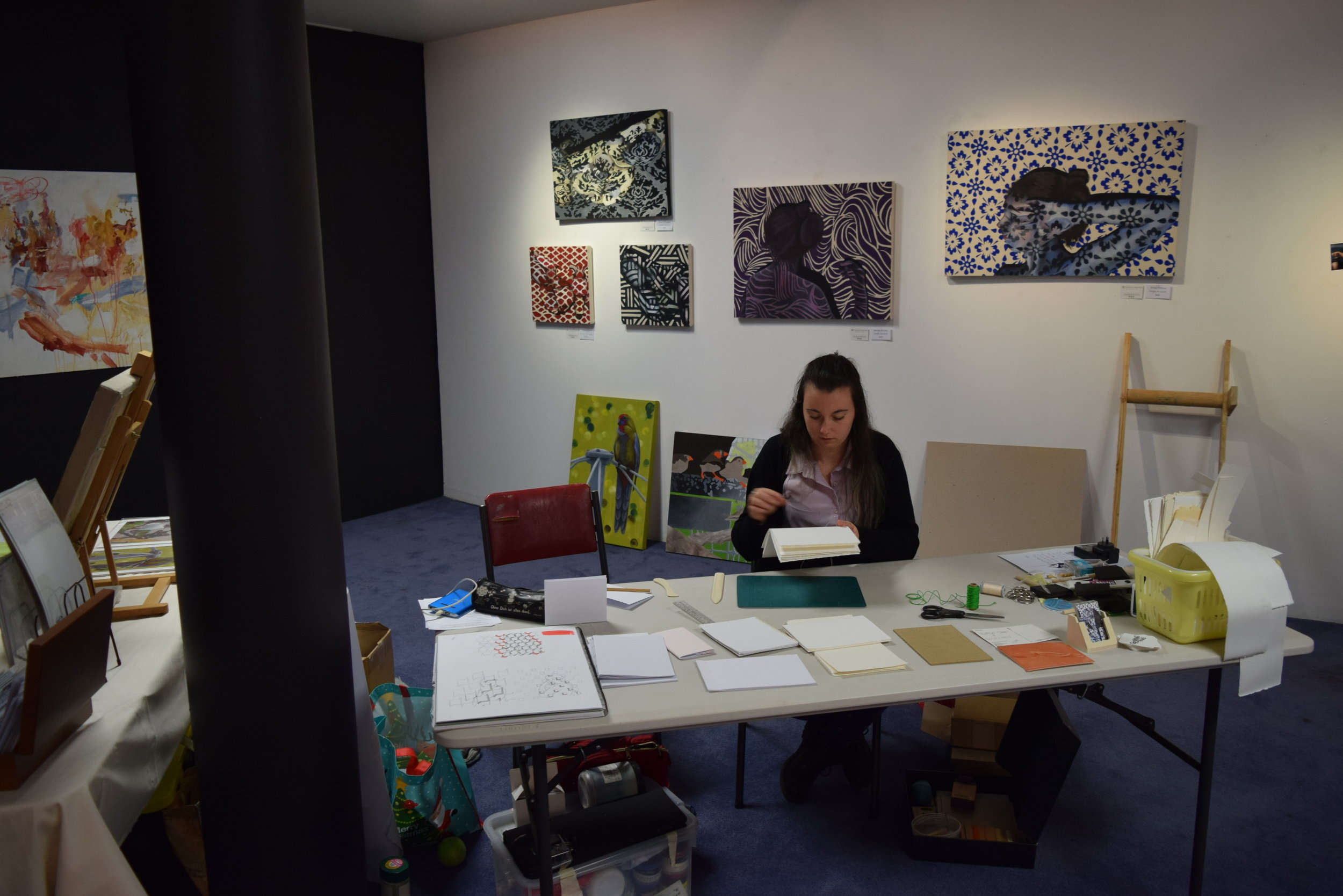 Growing Pains team member Katherine Reynolds doing some bookbinding during Open Studios