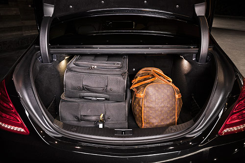 The trunk of the Mercedes-Benz S class has enough space for 2-3 medium sized pieces of luggage.