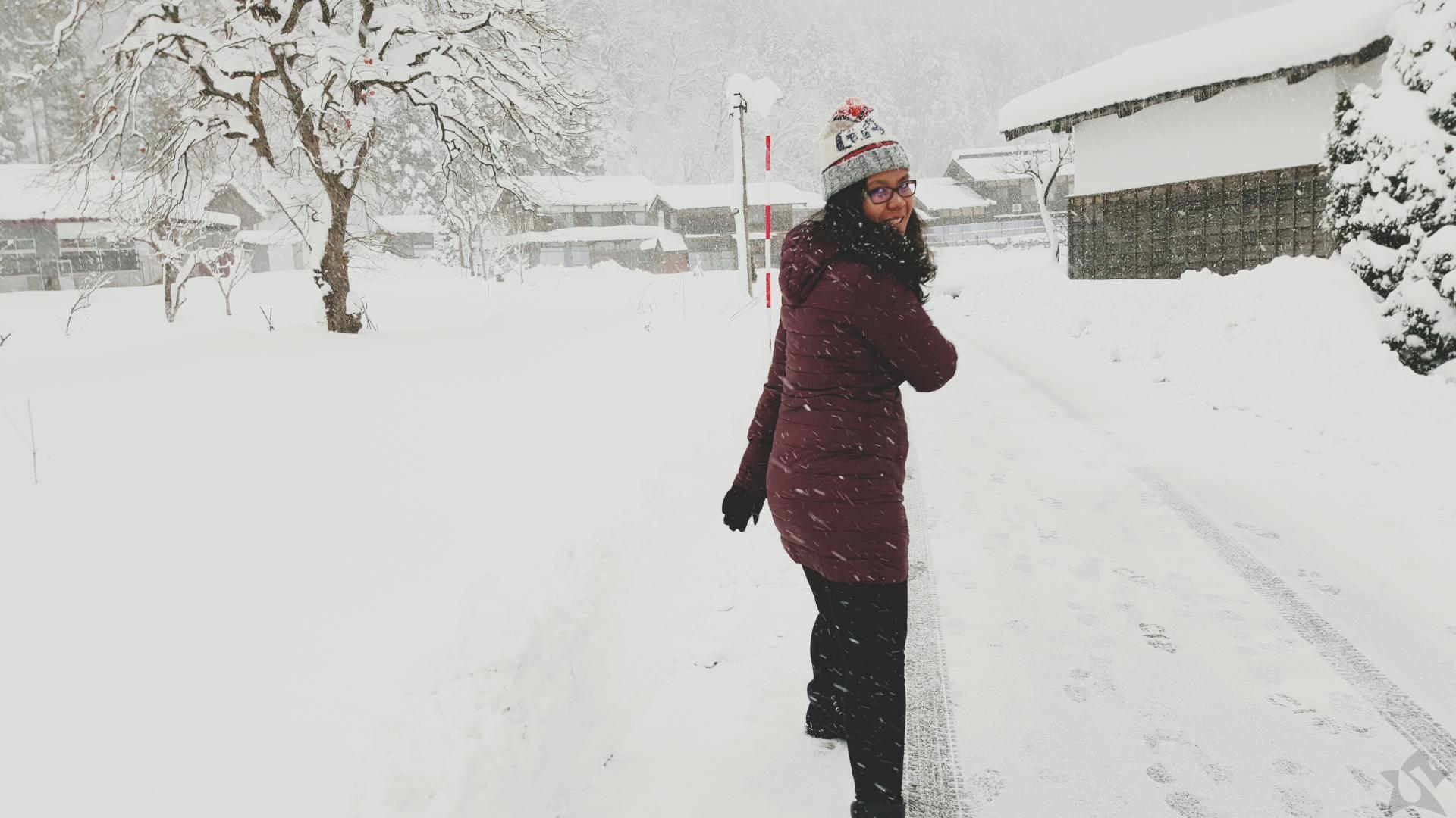 Girl in a Snowfall in Shirakawago Japan