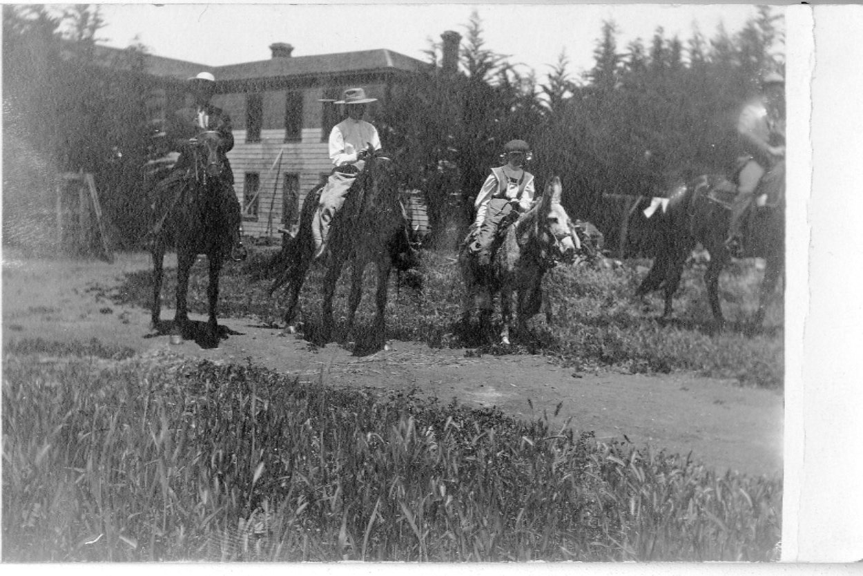 Riders behind the hotel, circa early 1900s.