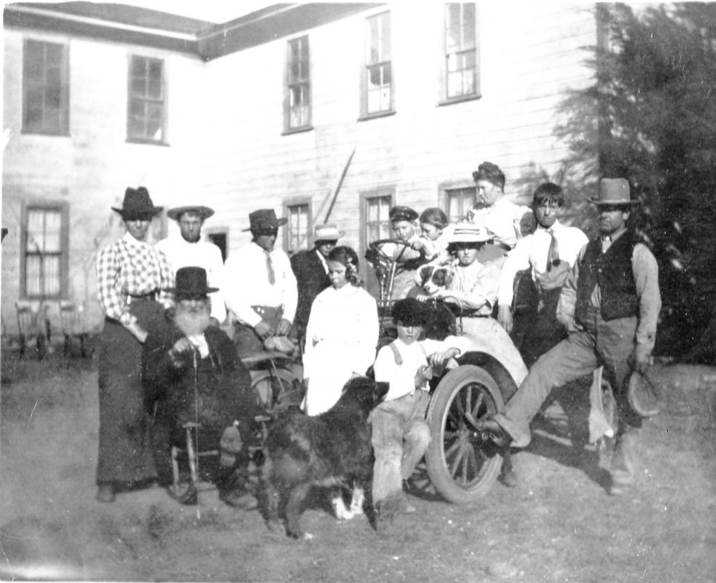 A group gathered behind the hotel, circa early 1900s.