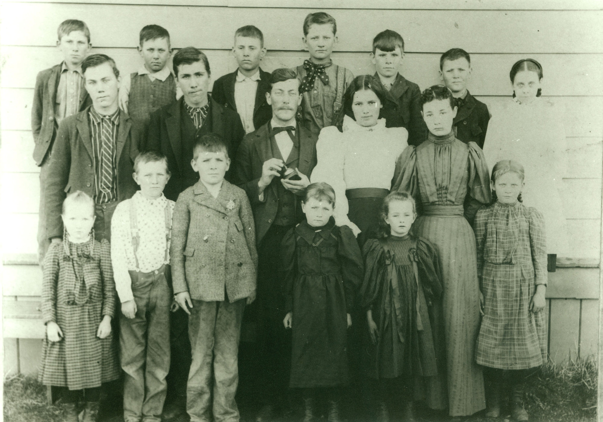"""1898 Timber School Students and teacher E.S. McGrew. William Washington """"Washie"""" Hays is 3rd from left in back row. 6th grader Simon Hays is 2nd from left in back row."""