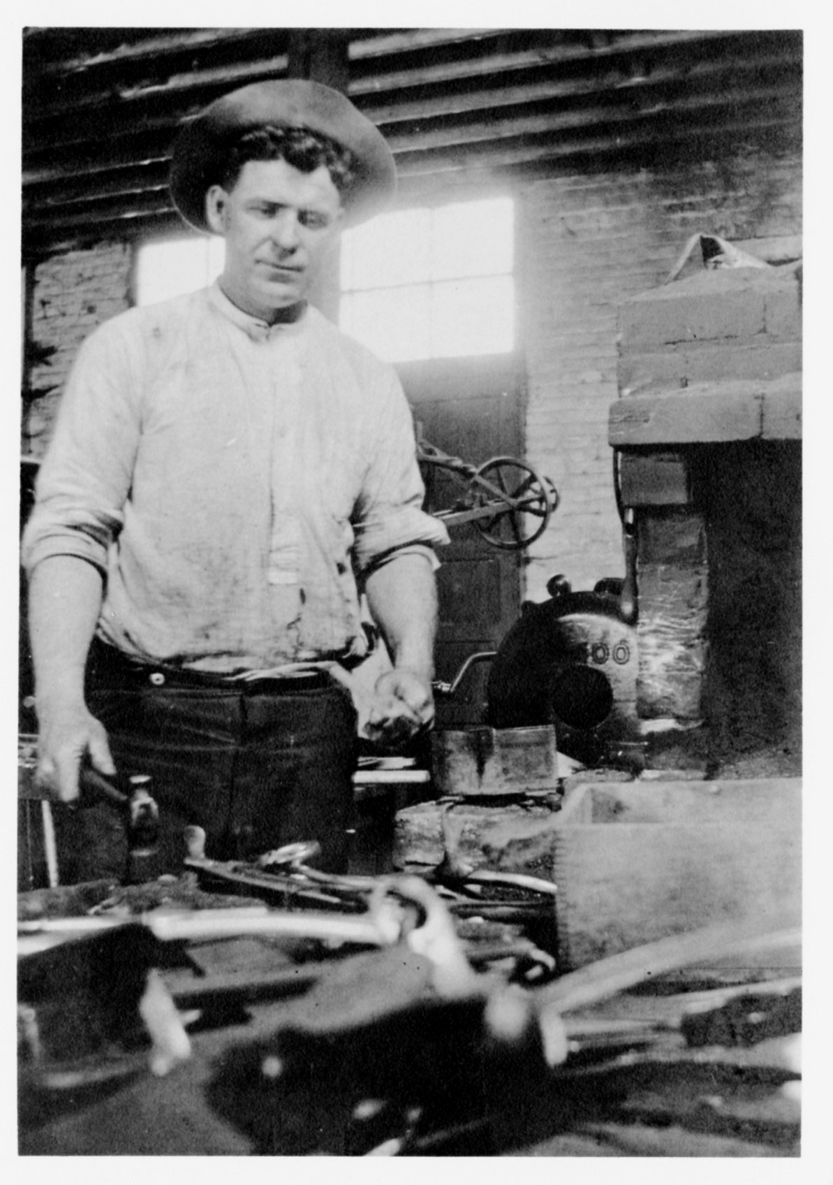Fred Hunt in his blacksmith shop, 1915
