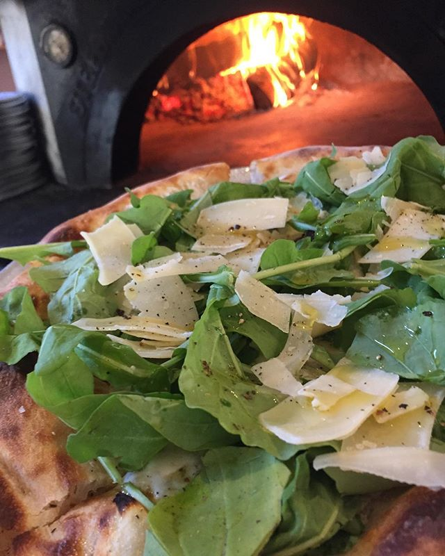 Local arugula, shaved Parmesan, mozzarella and garlic.  #scrummy #eatit #naturallyleavened #woodfiredpizza #pizzalife