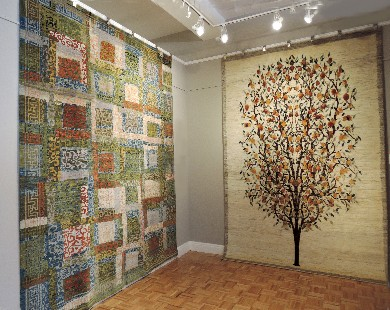 A Khotan-inspired design from Wool & Silk Rugs hand-knotted in Afghanistan (left) and a Luri wool Tree of Life design woven in Iran by Zollanvari are displayed gallery-style at Sarasota's Art to Walk On.