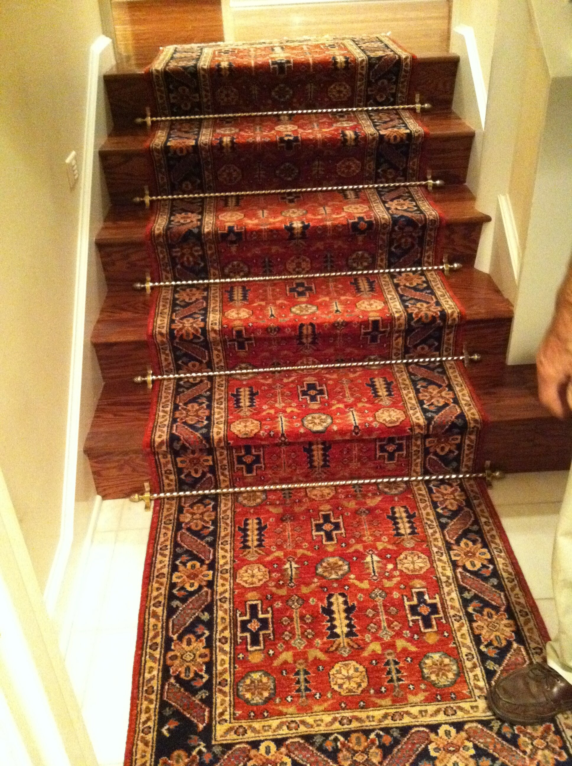 Runner, hand knotted in Afghanistan. Installed by Art To Walk On, using solid brass stair rods.