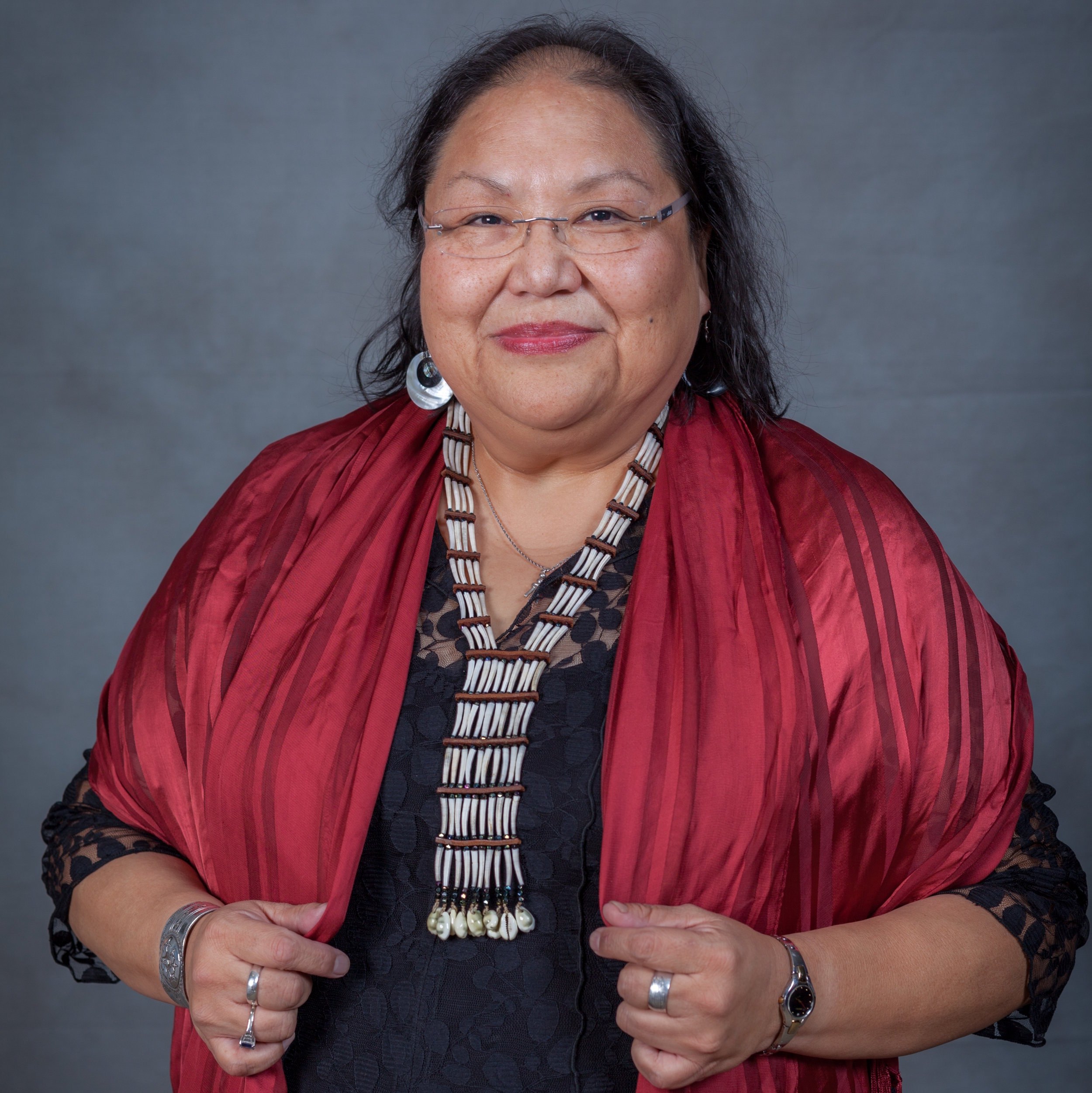 """Elizabeth Woody   Elizabeth Woody is an enrolled member of the Confederated Tribes of Warm Springs, Oregon, of Yakama Nation descent, and is """"born for"""" the Tódích'íinii (Bitter Water clan) of the Navajo Nation. Her paternal grandfather's clan is Mą'ii deeshgiizhinii (Coyote Pass, Jemez clan). Woody has published three books of poetry and also writes short fiction, essays and is a visual artist. She has been the recipient of the American Book Award and the William Stafford Memorial Award for Poetry, was a finalist for the Oregon Book Awards in 1995 and is currently Poet Laureate of Oregon. Woody is alumna of the first Kellogg Foundation's Fellowship through AIO's Ambassadors program and she leads writing workshops, lectures and has served on multidisciplinary art fellowship jury panels for several foundations and arts organizations nationally. Woody is presently on the Board of Directors of Soapstone and Willamette University Advisory Council for Native Programs."""