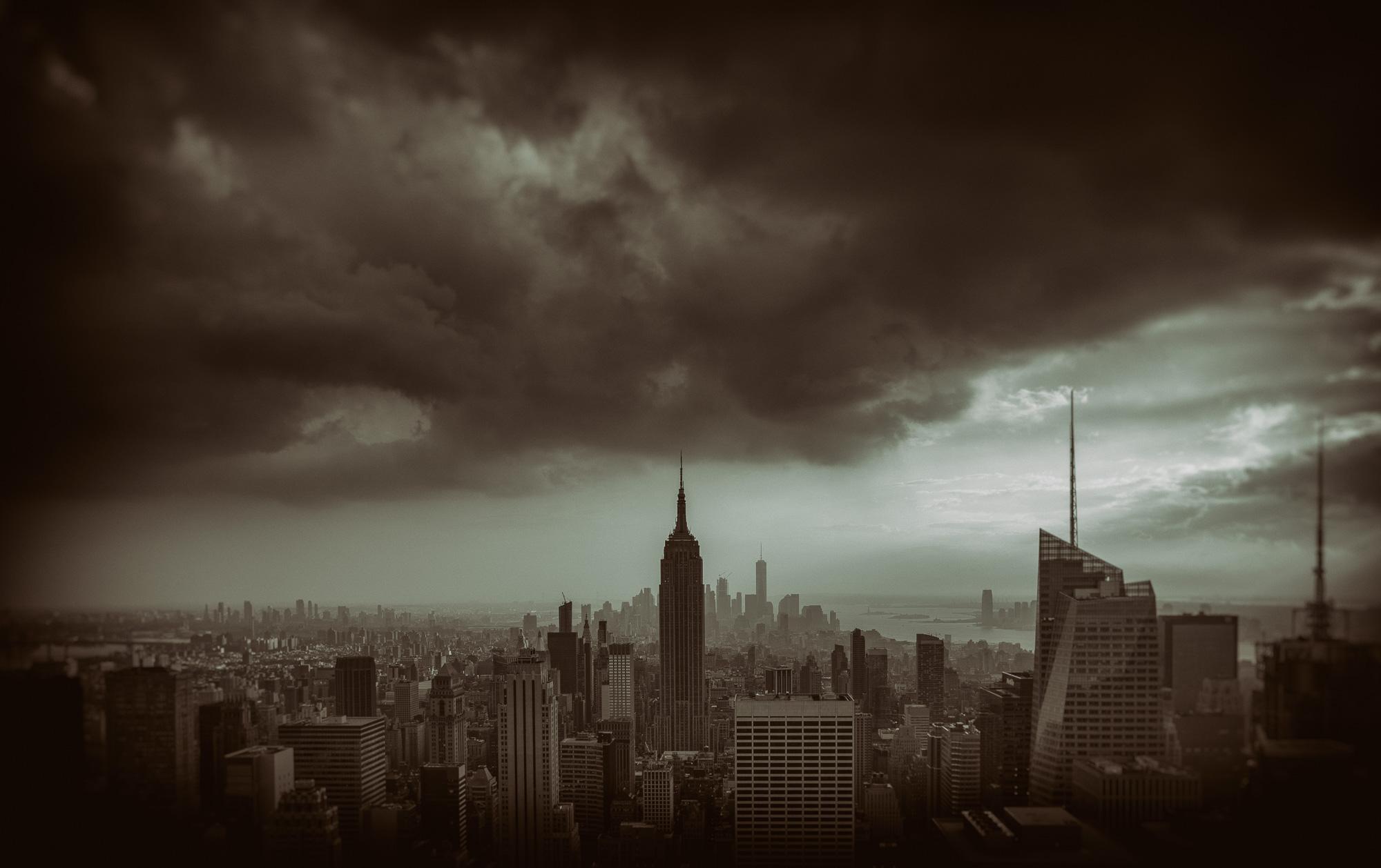 Dusk over Manhattan skyline with dramatic cloud