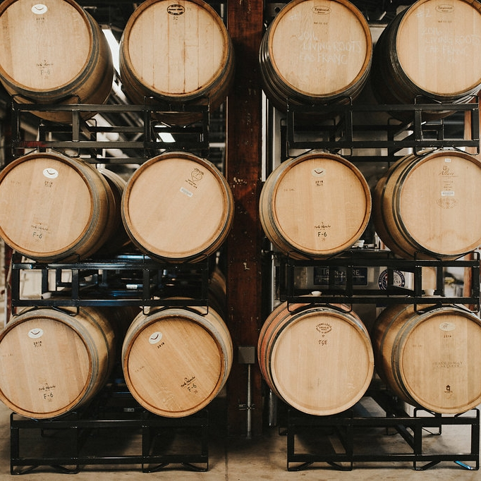 French barrels stacked up and full of Finger Lakes wine in the Living Roots urban winery in Rochester, New York.