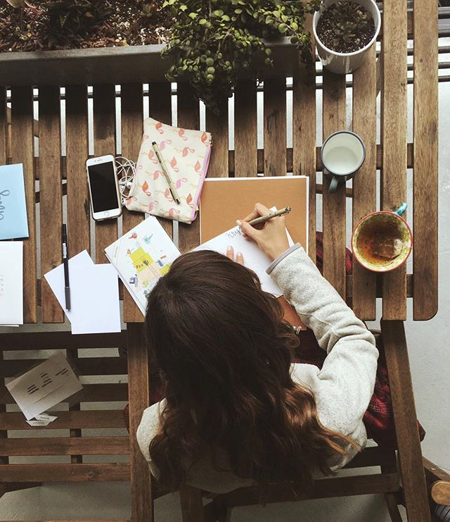My better half is a lot better (though it's pretty concerning she legit didn't notice me ominously standing on a chair behind her to take this picture). She's spending her Sunday afternoon sending letters to let people know they matter. Who does that? @lizireneallen does. Maybe we all should. #lazysunday #peoplematter