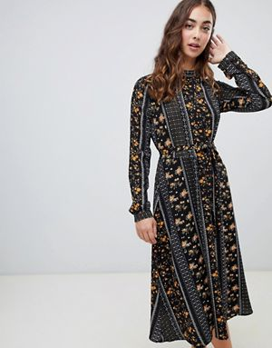 This nicely tailored dress was seen    on Asos    as well.