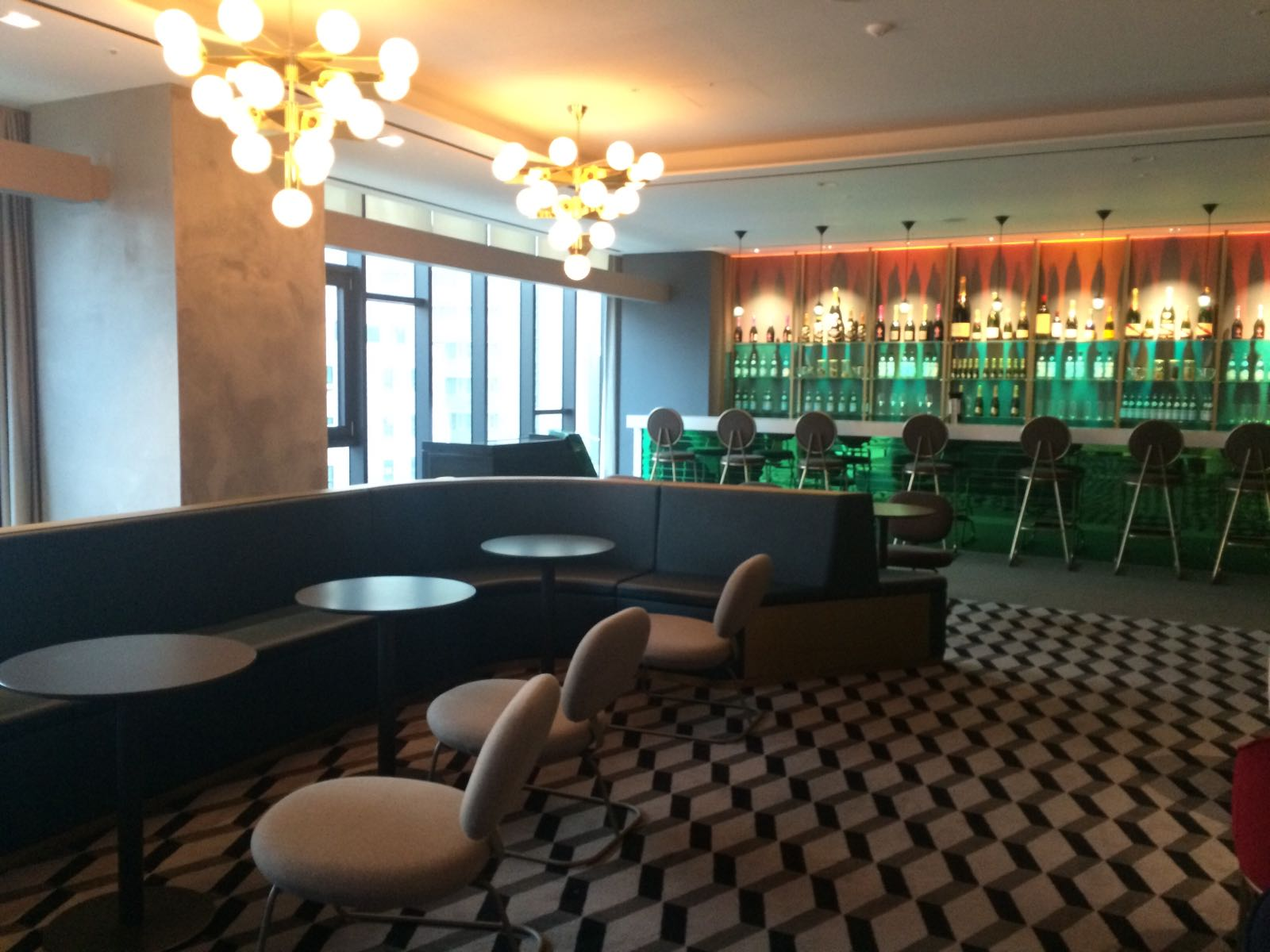 The bar and lounge area to the left of the reception area