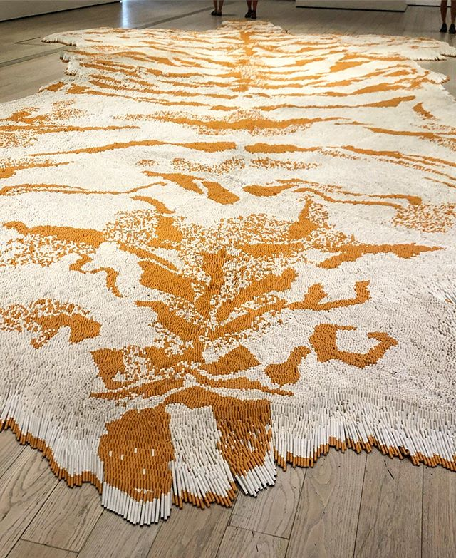 Xu Bing's installation 1st Class creates a luxurious tiger rug from cigarettes, a commentary on the glamorization if smoking. Dangerous but beautiful! Made from something like 500,000 cigarettes. #theallureofmatter