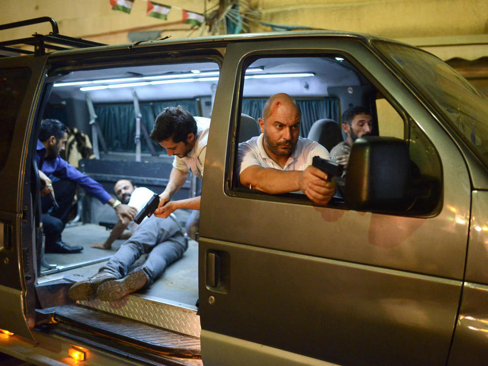 Door to Door: Lior Raz (Doron, front passenger seat) and fellow agents in Netflix's  Fauda