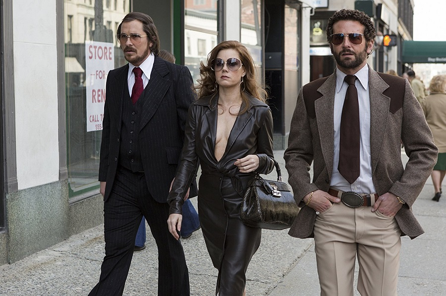 Uptown Funk: Christian Bale (Irving), Amy Adams (Sydney), and Bradley Cooper (Richie) in  American Hustle