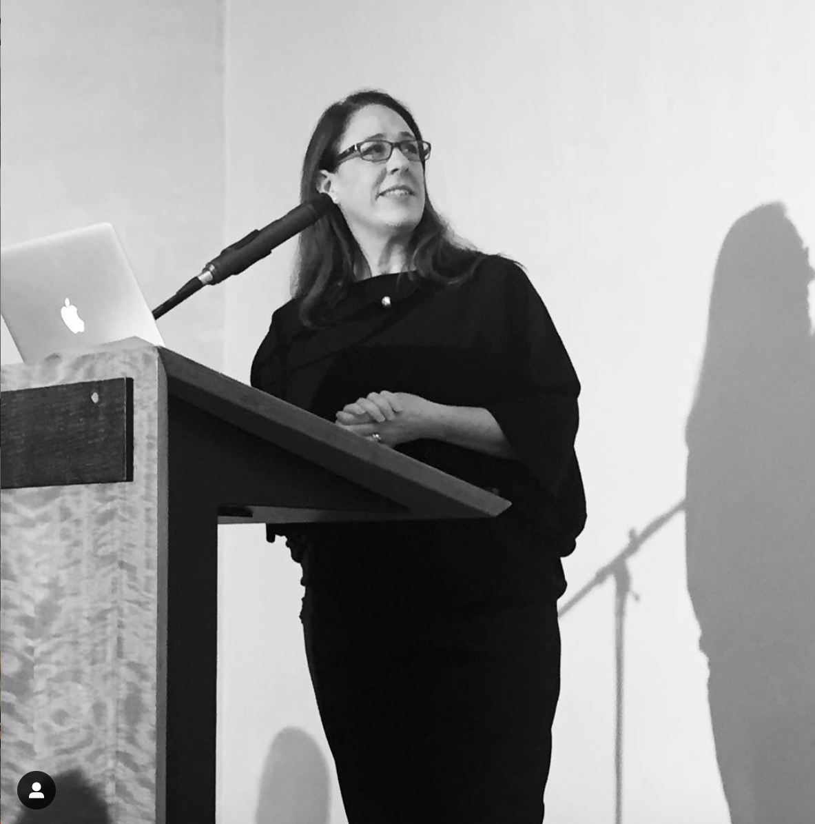 Jane Connory at the lectern, speaking at Design Tasmania's Women in Design conference. (Photo credit: Claire Beale)