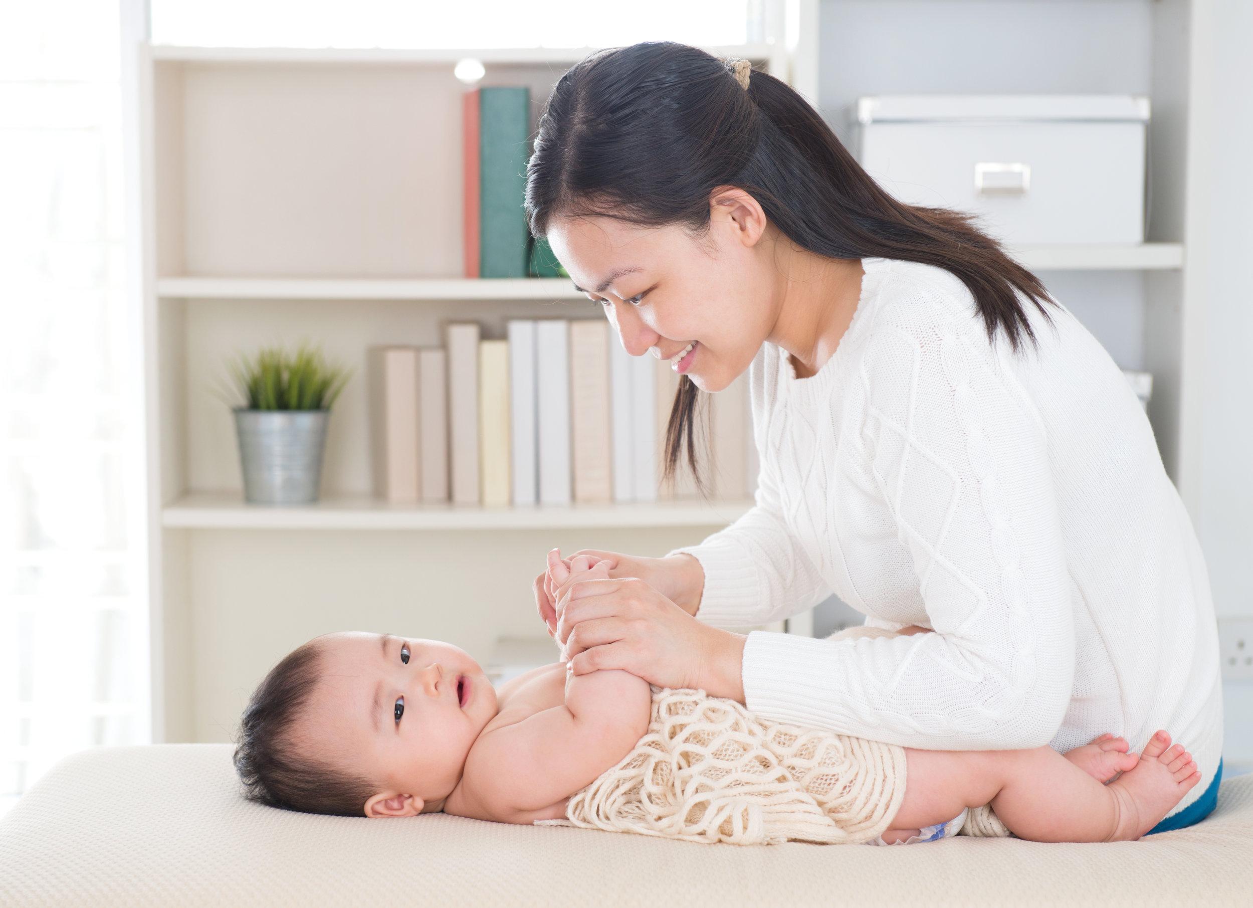 storyblocks-baby-massage-asian-mother-massaging-baby-hands-at-home_rLHnxVZeaz.jpg