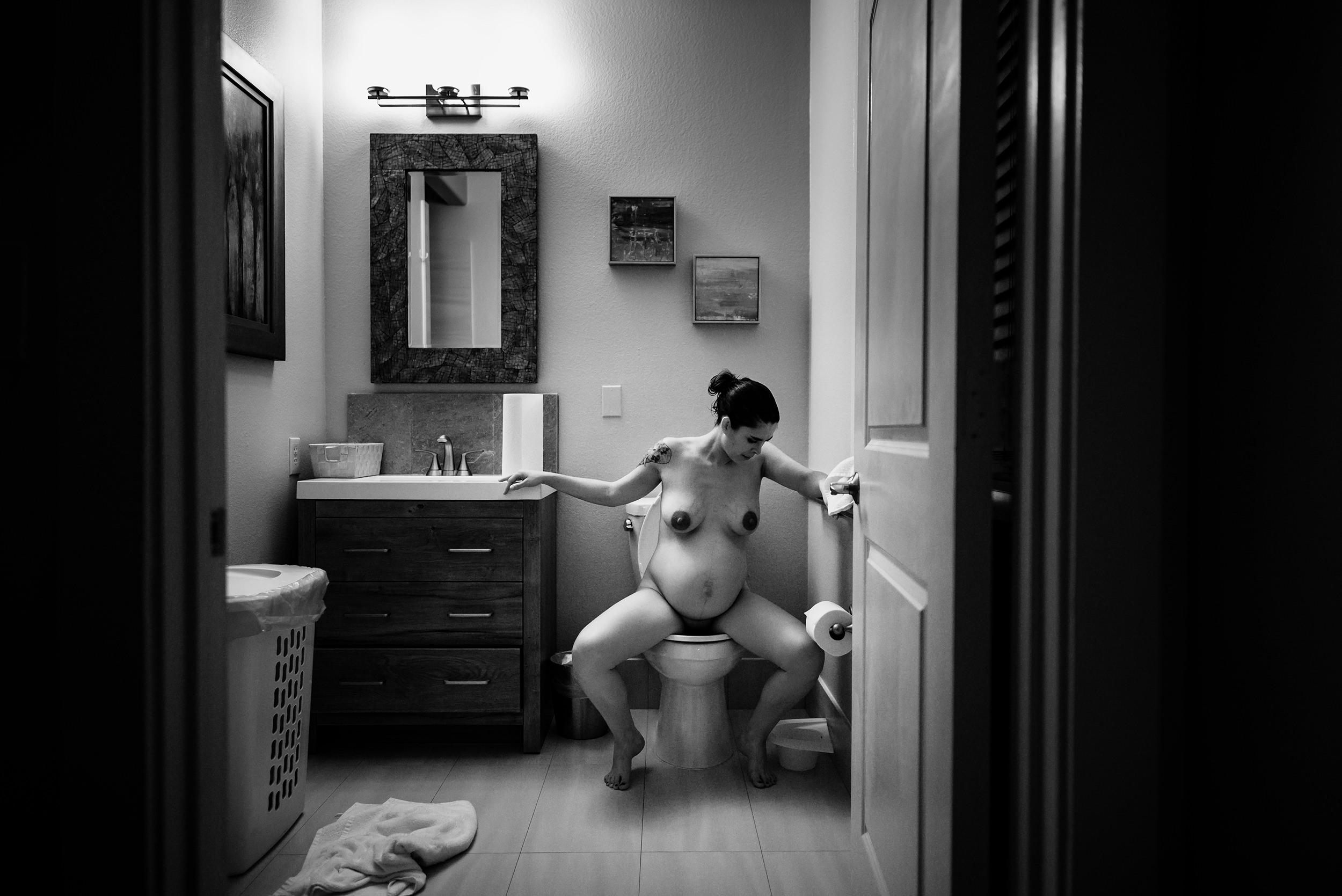 4 laboring on the toilet austin birth photography.jpg