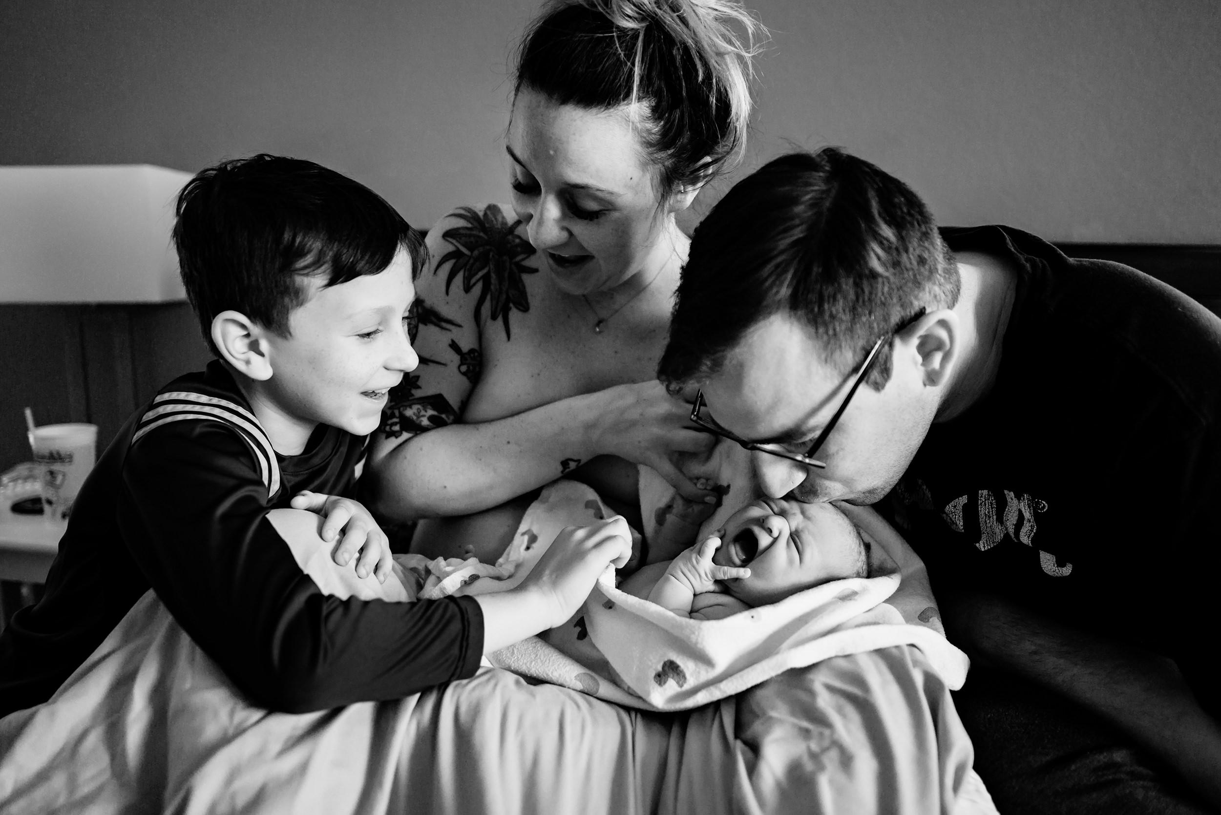 6 homebirth postpartum family scene siblings meeting.jpg