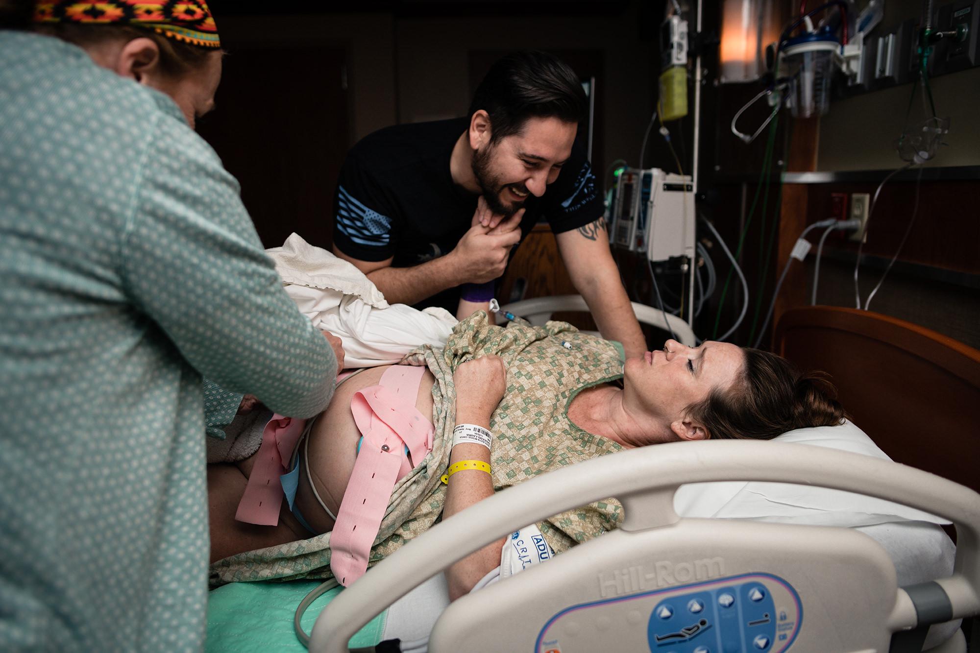 1 mom laboring in hospital bed austin tx.jpg