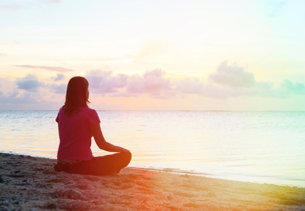 woman on beach meditating.jpg