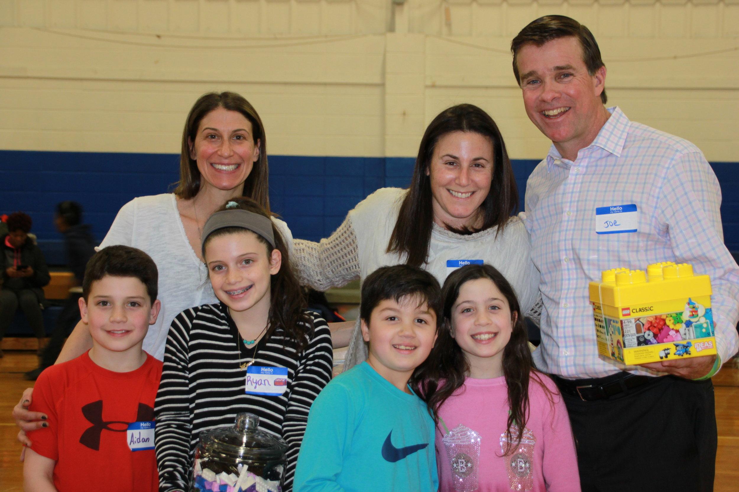 Dana Czuczka, Stacy Barenberg, their children, and Carver's Joe Gallagher