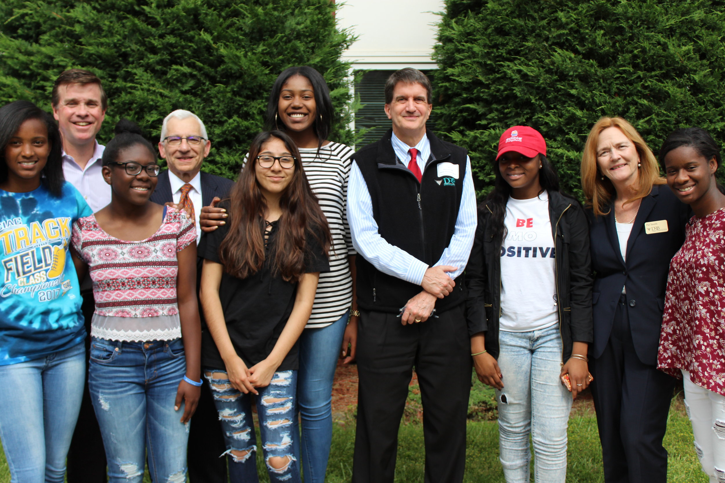 Standing with Carver students, (L-R) Joe Gallagher, Carver's Director of Philanthropy;Robert Mantilia, SVP; Malcolm Hall, Business Development Officer; and Pat Smith, Rowayton Branch Bank Manager