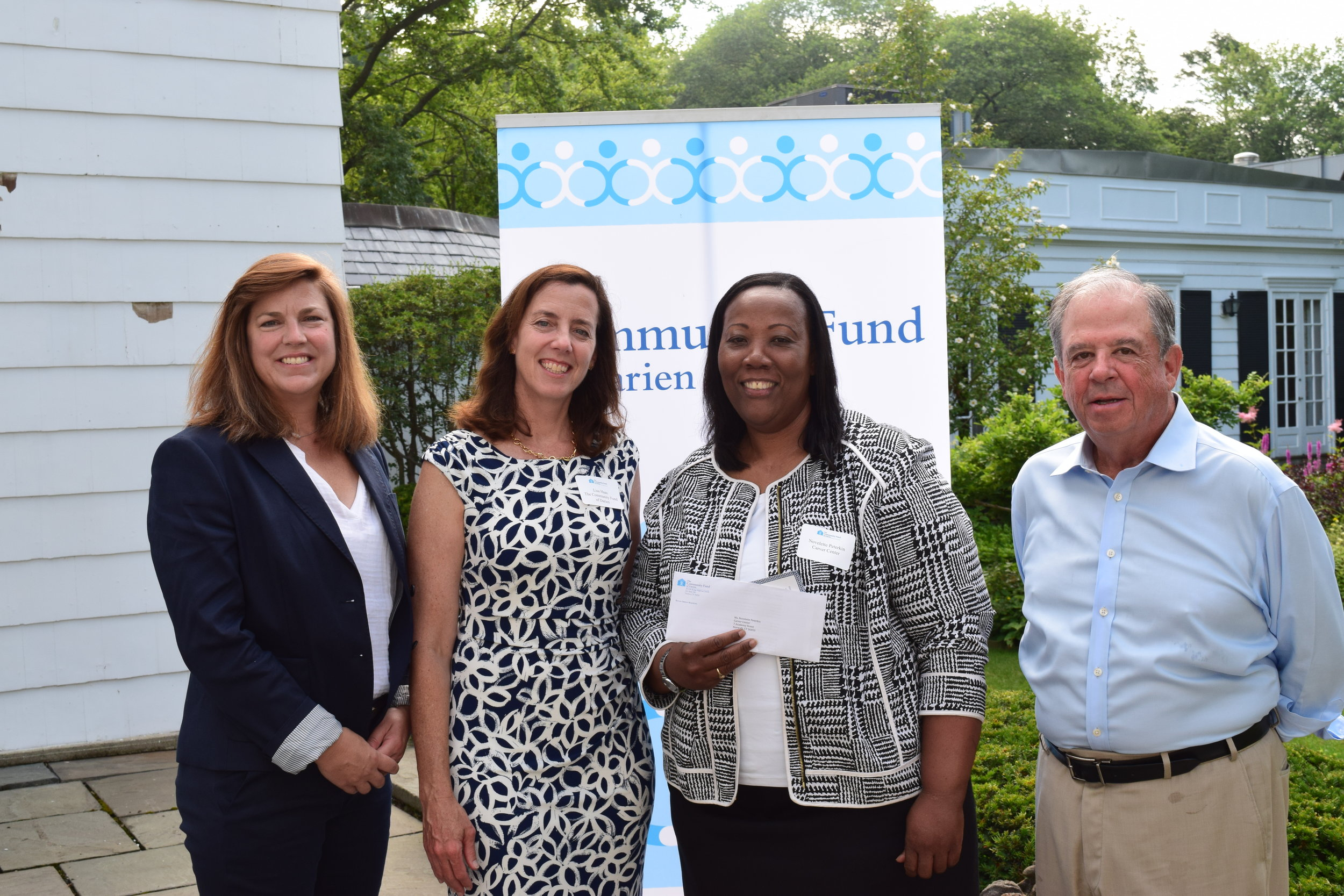 Carrie Bernier, Executive Director, and Lisa Hass, Grants Director, The Community Fund of Darien; Novelette Peterkin, Carver's Executive Director; and Steve Ward (President, Board of Directors, The Community Fund of Darien, and a member of Carver's Finance Committee