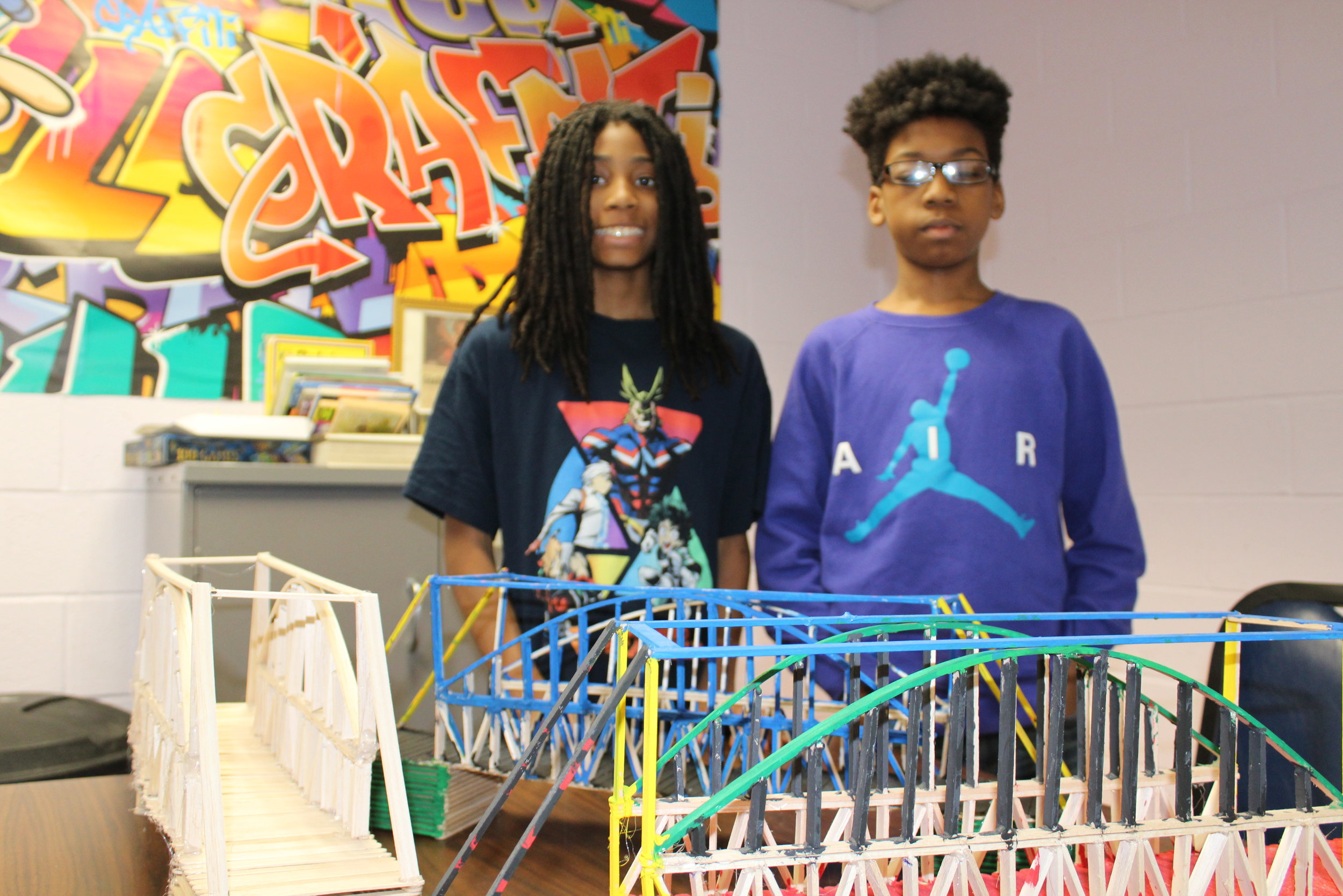Anthony and Deshaun standing next to their creations at the Carver Community Center