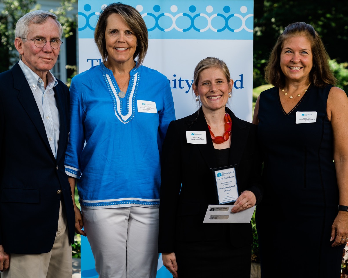(L-R) The Community Fund of Darien's incoming Board President, Frank Huck;the Board Chair of Grants, Cindy Banks; Nikki LaFaye, Carver's Director of Philanthropy;and the Community Fund of Darien's Director of Development, Laurie Orem.